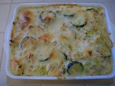 Shelly's Zucchini and Chicken Bake - zucchini and/or summer squash, yellow onion, green onions, canned white meat chicken, Greek yogurt and/or sour cream, shredded Mexican blend cheese, eggs, fresh salsa, oregano, kosher salt, black pepper, grated Parmesan cheese