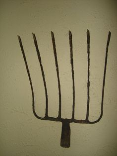 old large antique hand wrought iron pitch fork top, from france. great to use as wall hanging. all iron is hand forged . nice old primitive piece.