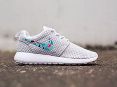 Gray and colorful Nike sign roshes