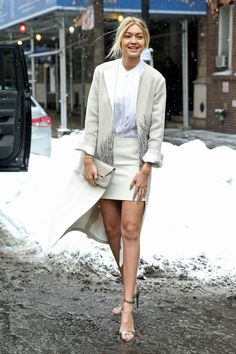 Gigi Hadid looks flawlessly chic while braving the cold in a miniskirt.