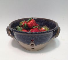 Berry bowls.  You use yours religiously every day, and now I do too!  Who doesn't like fresh berries at every turn?  This along with your good taste in other pottery makes your dish ware an eclectic collection of local artisans.