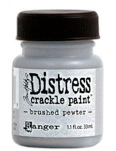 RANGER: TIM HOLTZ - DISTRESS CRACKLE PAINT - BRUSHED PEWTER Distress Crackle Paint er en maling som lager en eldet effekt - krakelering. Legges det på et tynt lag med maling får du effekten av små sprekker. Ved ett tykt lag får du kraftigere sprekker i malingen. Malingen sprekker når den ligger å tørker.   http://www.kreativscrapping.no/categories/tim-holtz-distress-crackle-paint