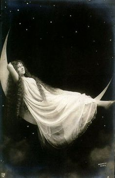 Vintage paper moon portrait of a girl in a nightgown reclining on the moon