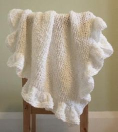 This beautiful knit baby blanket is a traditional design sure to be cherished for years to come.