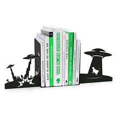 Set of two black metal depict an alien invasion scenario in silhouette. Will keep your books propped up on the shelf, though anti-gravity may be required for these to function outside of Earth's gravitational pull.