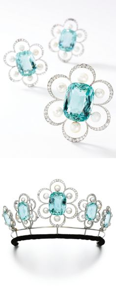 Aquamarine, natural pearl and diamond brooches, Georges Fouquet, 1908, later tiara fitting Designed as five graduated floral motifs, each set with a cushion shaped aquamarine within a petalled border of circular-cut and rose diamonds and natural pearl accents, the pearls measuring from approximately 5.00 to 8.50mm, on a later tiara frame, five detachable brooch pins and a pair of earring fittings and two later fitted cases.