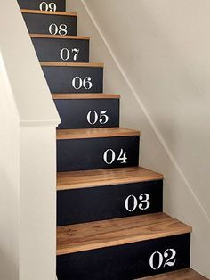 Escalier peinture noir chiffres / stenciled numbers on plywood / nailed to their stair risers (painted Black Suede by Behr).