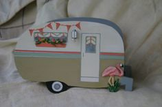 Handmade and hand painted vintage travel trailer camper all dressed up in nostalgia!  Cute camping decor! This sweet lil vintage travel trailer camper can be used as a gift basket or it is the perfect size to hold napkins in YOUR travel trailer! . Perfect for the happy campers who have everything! This camper measures 7 1/2 long x 4 1/2 high and 4 1/2 wide  Can do custom orders, just convo me