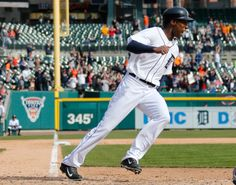 DETROIT, MI - APRIL 02: Austin Jackson #14 of the Detroit Tigers celebrates as he crosses the plate to score the game winning run in the 10th inning after a Ian Kinsler #3 single to beat the Kansas City Royals 2-1at Comerica Park on April 2, 2014 in Detroit, Michigan. (Photo by Gregory Shamus/Getty Images)