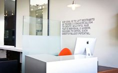 beautiful front desk & wall text - Memo Salon