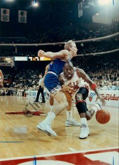 The GOAT goes for the aggressive drive on the Cavs Craig Ehlo during the 90 playoffs in Chicago.