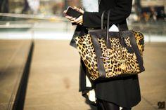 Céline-Leopard skin bag-black coat-tees chic!-(also love her hot pink phone case.)
