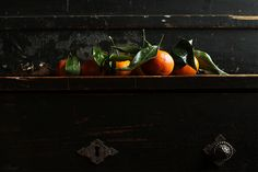 Mandarins on vintage commode by almondcorner, via Flickr