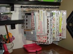 another space saving idea for storing scrapbook stuff  I use large safety pins for for hanging and a push curtain rod to hang on and it is great.  I can find what I'm wanting in a glance and don't forget what I have.  lol