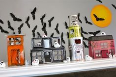 Halloween village made with recyclables and rocks painted to look like ghosts