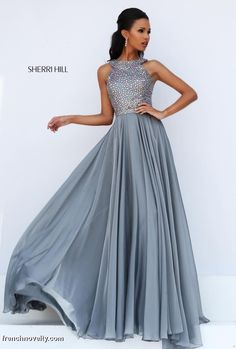 Sherri Hill 50615 is a long ball gown with a racer back and a beaded top.