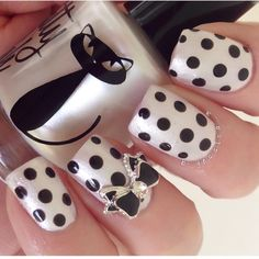 Pearl and Black Polka Dot Nails With Black and Silver Bow