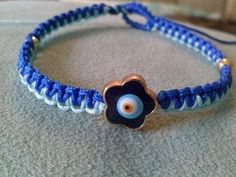 *only+available+upon+request*  Handmade+Royal+&+Light+Blue+Satin/Polyester+cords+woven+with+bead+accents+and+flower+shaped+evil+eye!+Fits+6-8+inch+wrist.+OOAK