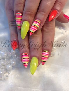 Stiletto Natural Nails with an Overlay of Nail Perfects Sculpting soft pink gel. #33, #34, #71 Nail Perfects Soak Off Gel Polish with a Stripe Design on the First and Ring Fingers. #kelseyleighnails #nail #nailart