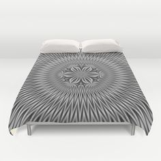 A digital abstract fractal image with a floral motif in a circular design in black and white by Objowl.