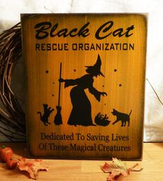 Halloween Sign Black Cat Rescue Organization Painted Wood Sign, via Etsy.
