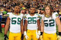 Aaron Rodgers and Matt Flynn Photobombing captain picture.