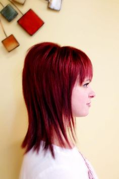Vibrant red color with a razor cut by Sam