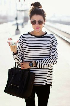 Striped shirt and black leather handbag and a starbees and a top knot. Yes please