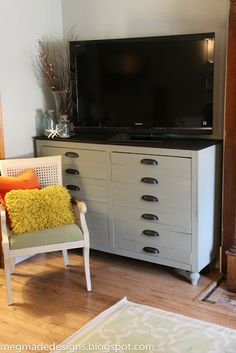 """A Brilliant TV console idea! By 'meg made designs': she took an upright Ikea bookshelf and transformed it into a Vintage Printer's Cabinet...by turning it on it's side, adding feet, and making the doors like like drawers!"""""""