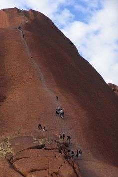 Climbing Ayers Rock. Image by Masao.M