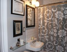 Our tiny 50's bathroom got a much needed makeover featuring white subway tile with charcoal gray grout, a gray, black and turquoise color scheme and a bit of a boho vintage shaving theme.  Diploma???