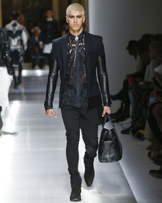 It is great to see that leather still makes its presence known on the runway. The Balmain fashion show features delightful leather touches on their men's jackets.