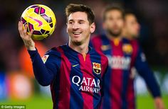 Lionel Messi pictured with the match ball after scoring a hat-trick in Barcelona's win ove...