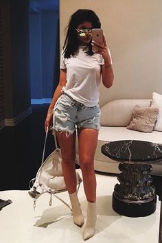 pinterest @esib123  kylie jenner in white booties and denim shorts.