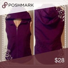Sporty Eddie Bauer Hooded Vest Fabulous used condition vest in an eggplant color. Gathered in back to flatter. Hood has adjustable pulls. Nice for layering when unsure of temperatures. Eddie Bauer Jackets & Coats Vests
