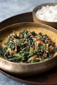 """NYT Cooking: """"Red lentils are the king of weekday cooking,"""" said Meera Sodha, the British cookbook author. In this robust dish, she turns to quick-cooking red lentils, deepening their flavor with fried green chiles, garlic and ginger. It's not traditional to serve the kale on top, but it turns a simple dish into a luxurious, complete meal: Just add hot rice and a spoonful of yogurt..."""