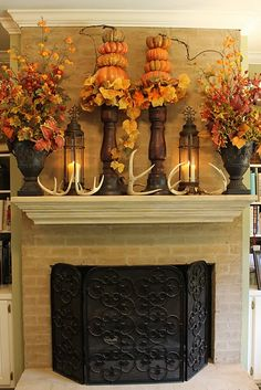 Fall mantle decor. I love the pumpkins stacked on candle sticks and the antlers.