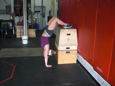 Headstand Pushup (HSPU) progression routine from Crossfit London. Good step by step instructions on how to eventually get HSPU's.