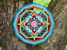 Jay Mohler creates intricate, textile designs, weaving different colored yarns to create brilliant Mandalas.