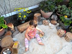 Eiya's Casita Small, Cool Outdoors #Entry #47 | Apartment Therapy- love the plants in pots all around the sandbox, and the tree stumps!