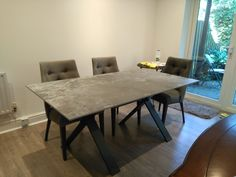 Fixed version of our Xenon dining table with Dekton Orix top and Graphite frame. FLORIDA dining chairs in Comfy Graphite and Graphite legs. Delivered to our client in Surbiton. Dining Chairs, Dining Table, Leather Bed, Sofa Design, Modern Bedroom, Contemporary Furniture, Graphite, Sideboard, Sofas