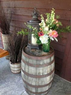 Wine barrel decor entrance centerpiece atop a whiskey with lantern our in wedding decoration ideas house Whiskey Barrel Decor, Whiskey Barrel Wedding, Whiskey Barrels, Wedding Ideas With Wine Barrels, Whiskey Barrel Flowers, Wine Barrel Planter, Wine Barrel Table, Rustic Decor, Farmhouse Decor