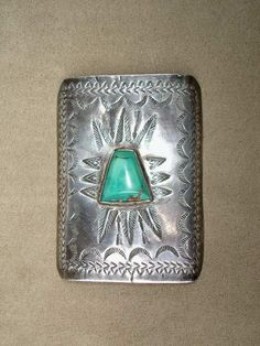Beautiful ingot silver bow guard panel, with feather and arrow stamp work, and border stamps as well. The turquoise is a trapezoid that is h...