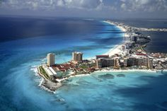 Cancún, Mexico, 21° 9′ 38″ N, 86° 50′ 51″ W  Cancún is a city in south-eastern Mexico, located on the north-east coast of the Yucatán Peninsula in the Mexican state of Quintana Roo. It is a world-renowned tourist destination, as well as being the seat of the Benito Juárez municipality. The city is located off of the Caribbean Sea, and is one of the eastern-most points in Mexico.