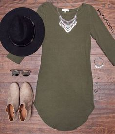 - Details - Size Guide - Model Stats - Contact It's greased lightning! This olive Sandy Basic Dress features a lightweight, knit fabric with stretch. Scoop neck front, three-quarter-length sleeves. Bo