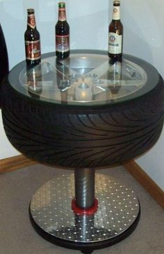 Car parts as everyday household items *For the Man Cave - a cool tire table. Tire Table, Tire Chairs, Tire Craft, Car Furniture, Automotive Furniture, Automotive Decor, Furniture Ideas, Automotive Upholstery, Furniture Design
