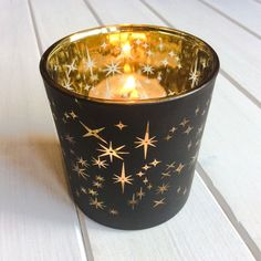 Gold Stars Votive - Large Cosy down with these gorgeous flickering star votives The clear star shapes in the coating of the glass cast beautiful flickering star patterns around the room once the candle is lit.  Why we love this product:      Casts a dazzling stellar display once lit     They look amazing on their own of as part of a group     Complete with tea-light candle to enjoy straight away!     Also available in a smaller size.  #candles #glass #votives #stars #rustic #home #interiors…