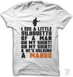 I see a little silhouetto of a man, on my shirt! on my shirt! and he's holding a mango!
