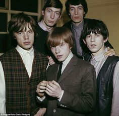In the beginning: The Rolling Stones in 1963. Front row, left to right, are Mick…