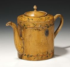 An extremely rare (and most likely Unique) tea caddy in the form of a teapot, the fruitwood carcass painted and decorated with trailing vines and gilt highlights possibly continental. £18,000 Richard Gardner Antiques
